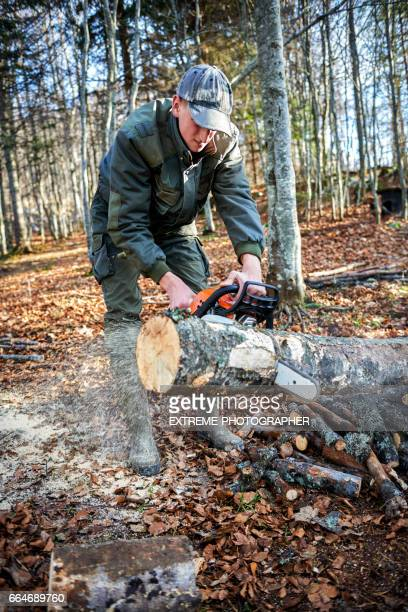 Man working with chainsaw