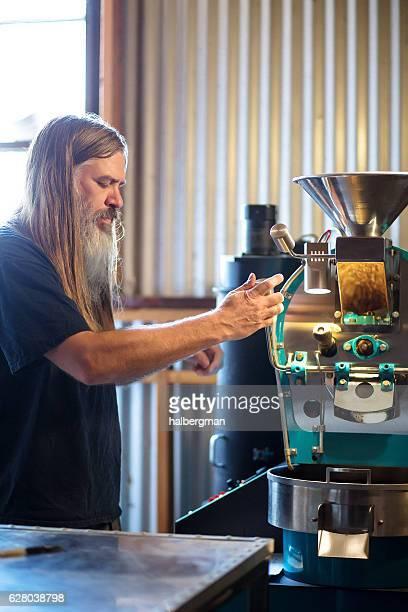 Man Working with Coffee Roasting Machine