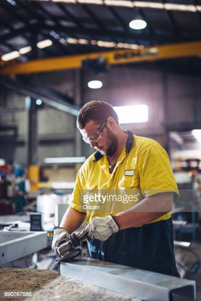 Man working with grinder in Australian manufacturing company