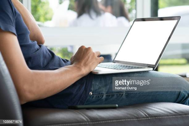 man working with laptop computer.blank screen laptop for insert graphic objects. - laptop mockup stock photos and pictures