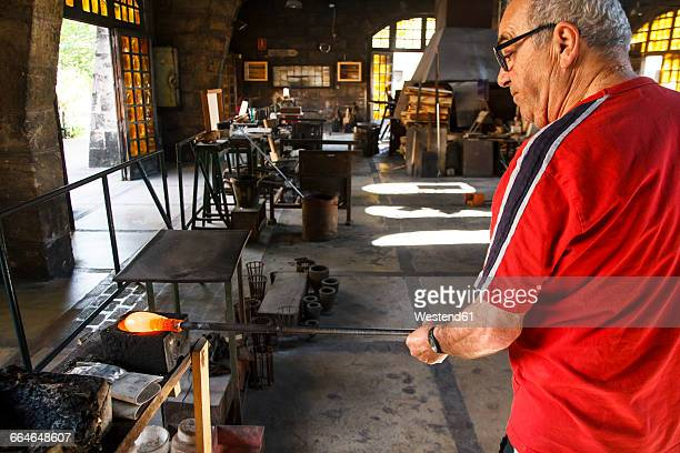 Man working with molten glass in a Factory in Mallorca