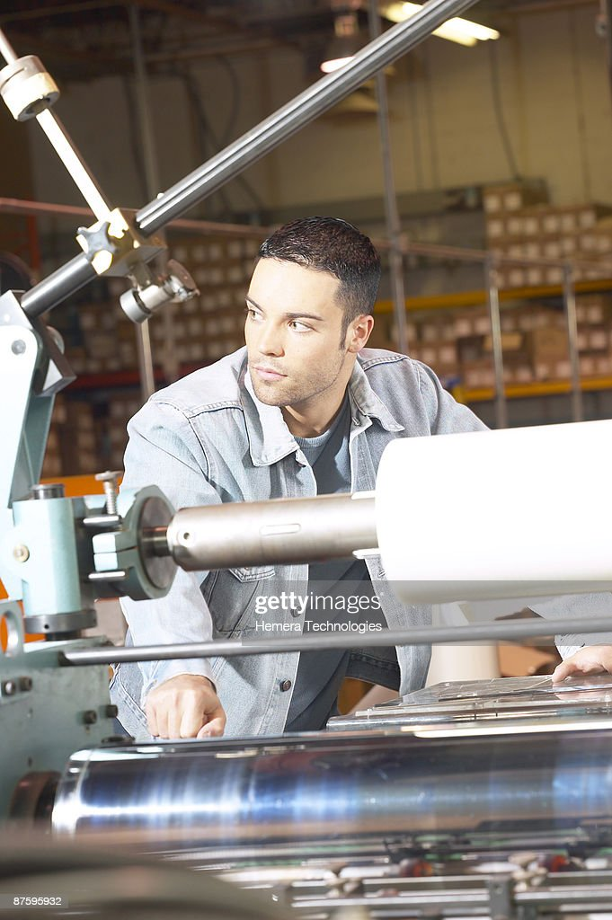 Man working with printing press : Stock Photo