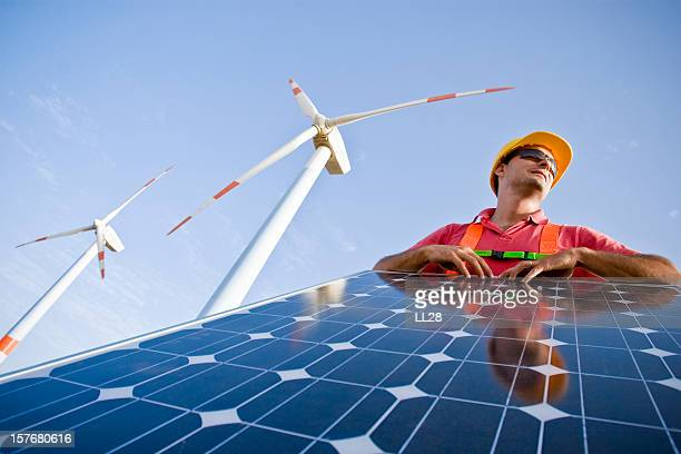 a man working with solar panels - energy efficient stock photos and pictures