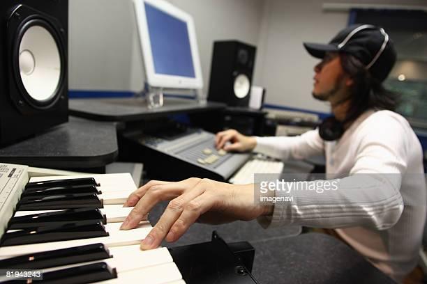 man working with sound mixer - 作曲家 ストックフォトと画像