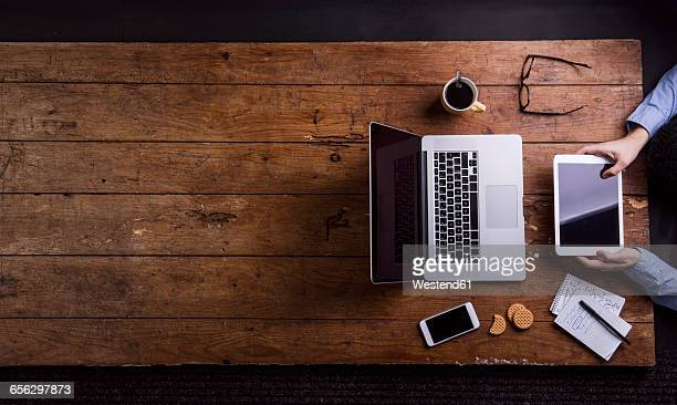Man working with tablet pc at desk