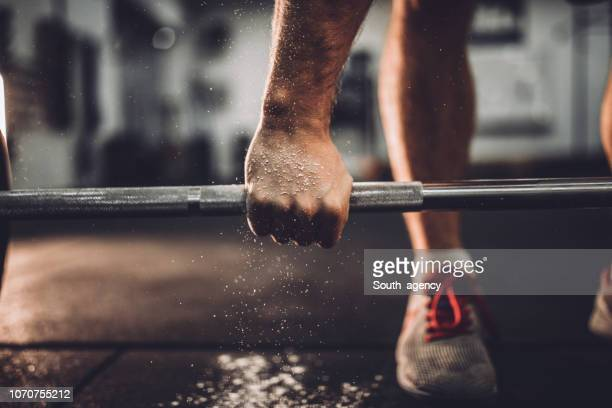 man workout in gym - barbell stock pictures, royalty-free photos & images