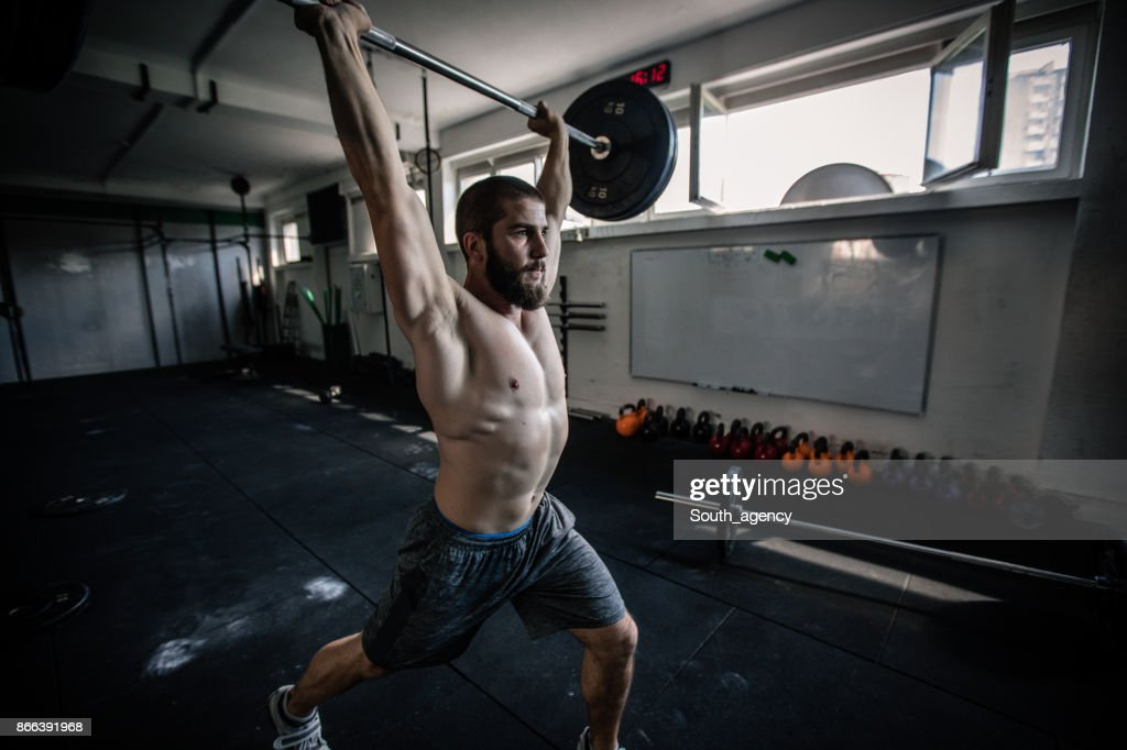Man workout with barbells in the gym : Stock Photo