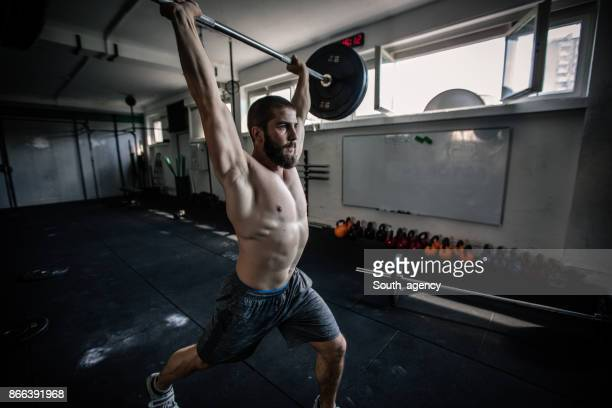 man workout with barbells in the gym - snatch weightlifting stock photos and pictures