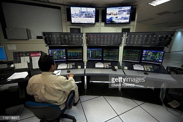 A man works at a control station at Mexican stateowned petroleum company PEMEX refinery in Tula Hidalgo state Mexico on March 8 2011 AFP PHOTO/OMAR...