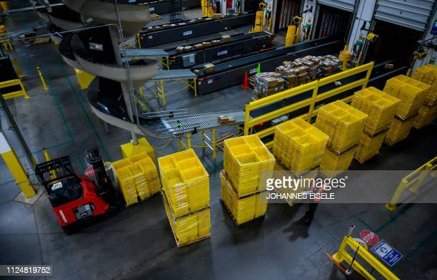 A man works at a distrubiton station at the 855000squarefoot Amazon fulfillment center in Staten Island one of the five boroughs of New York City on...