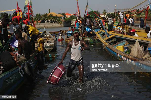 A man works at a fishing market on November 19 2015 in Conakry Guinea Guinea is currently counting down the necessary 42 days period required without...