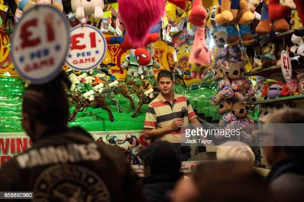 A man works at a fun fair game at the Nottingham Goose Fair in the Forest Recreation Ground on October 7 2017 in Nottingham England The annual goose...