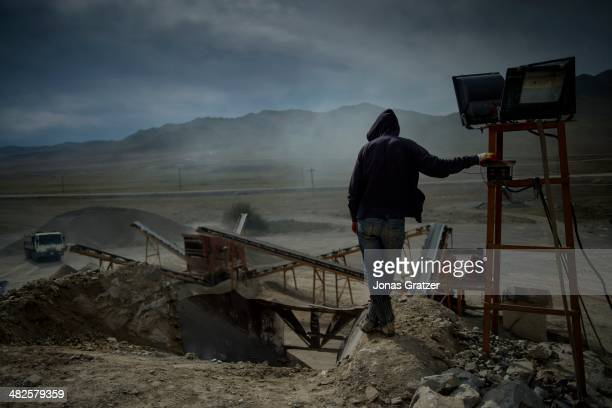 Man works at a mine with a stone crusher on the outskirts of the Sharyngol district in Mongolia where virtually everyone in the city works in the...