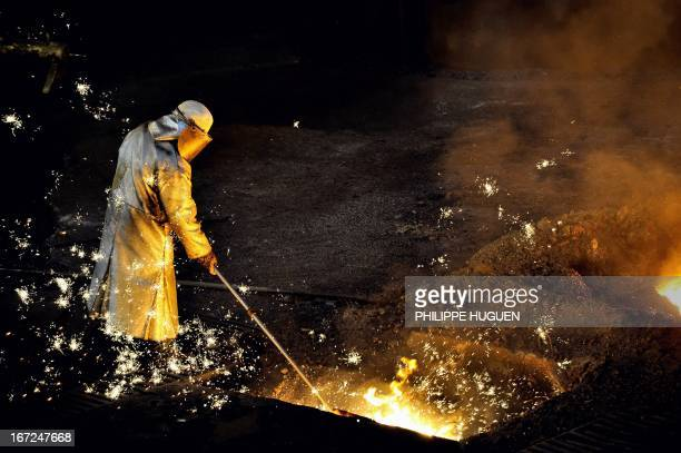 A man works at the blast furnace of the ArcelorMittal steel plant of GrandeSynthe northern France on April 22 2013 AFP PHOTO PHILIPPE HUGUEN