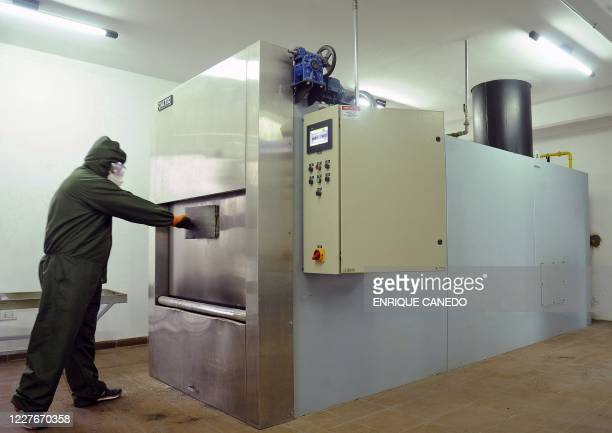 Man works at the crematorium of the municipal cemetery in Santa Cruz, Bolivia, on July 16 amid the new coronavirus pandemic. - The crematorium...
