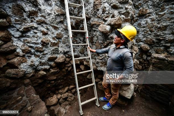 A man works at the substructure inside the Teopanzolco pyramid in Cuernavaca Morelos State Mexico on July 11 2018 After an earthquake took place on...