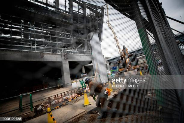 A man works at the under construction Ariake Arena venue for volleyball at the Tokyo 2020 Olympic Games and wheelchair basketball in the Paralympic...