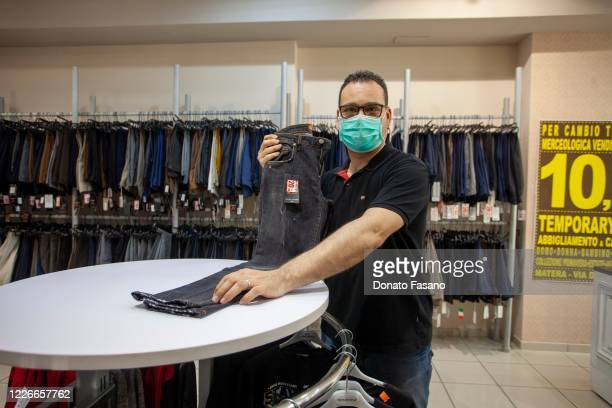 A man works in a clothing store on May 23 2020 in Matera Italy Restaurants bars cafes hairdressers and other shops have reopened subject to social...