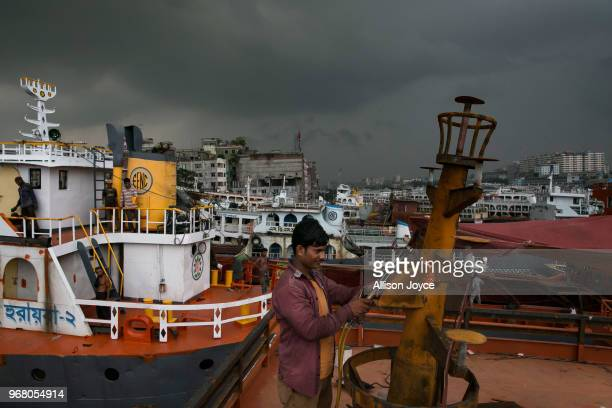 A man works in a dockyard on the Buriganga river on June 4 2018 in Dhaka Bangladesh Bangladesh has been reportedly ranked 10th out of the top 20...