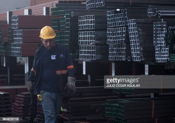 Man works in a steel distribution factory in Monterrey in northern Mexico, on May 31, 2018. - Mexico announced sweeping retaliatory tariffs on a host...