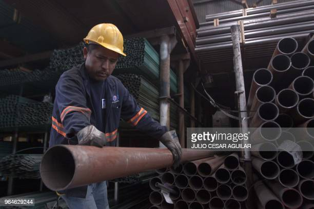 A man works in a steel distribution factory in Monterrey in northern Mexico on May 31 2018 Mexico announced sweeping retaliatory tariffs on a host of...