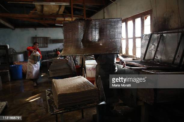 Man works in a traditional factory of handmade daphne paper on January 30, 2019 in Thimphu, Bhutan.