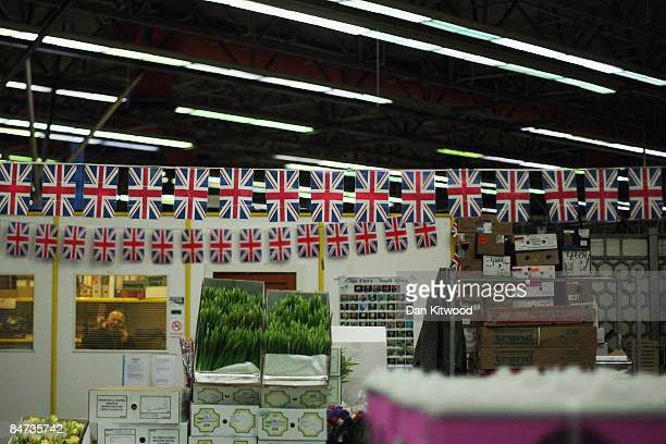 A man works in an office behind a stall in New Covent Garden Flower Market on February 11 2009 in London England New Covent Garden Flower Market is...