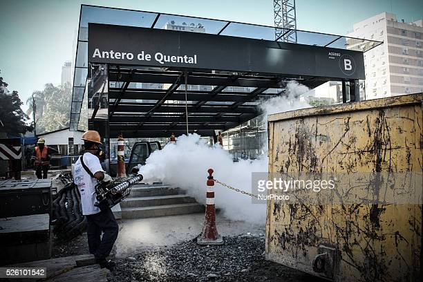 A man works in Rio de Janeiro during an awareness and prevention campaign against the mosquito Aedes aegypti the transmitter of Zika virus in Rio de...