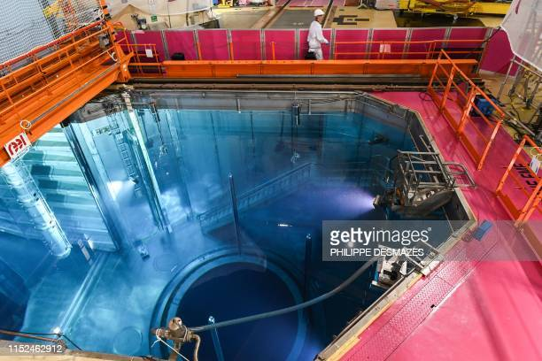 Man works in the hearth of the nuclear reactor building on June 27, 2019 at the Tricastin nuclear power in Saint-Paul-Trois-Châteaux, southern...