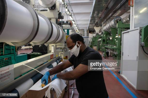 A man works inside the Cifra production plant on March 25 2020 in Verano Brianza near Milan Italy Cifra is a manufacturing company producing garments...
