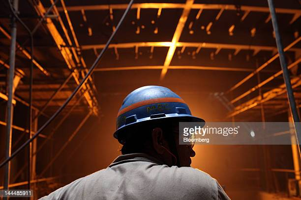 A man works inside the Jose de Alencar vessel a Petroleo Brasileiro SA oil tanker under construction at the Maua SA shipyard in Niteroi Brazil on...