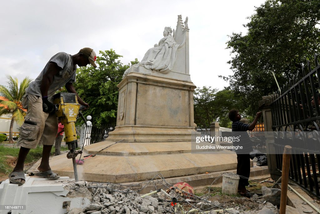 A man works next to a statue of Queen Victoria ahead of the Commonwealth Heads of Government Meeting (CHOGM) on November 9, 2013 in Colombo, Sri Lanka. The bi-annual gathering of Commonwealth leaders will take place in the Sri Lankan captial, Columbo, November 15-17. CHOGM will move forward despite some human rights groups urging leaders to boycott the meetings until Sri Lanka further investigates charges of war crimes. Canadian Prime Minister, Stephen Harper has already confirmed he will not attend.
