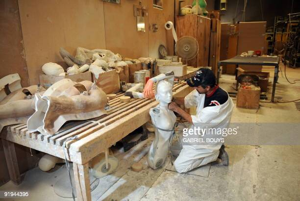 A man works on a mannequin at Patina V in City of Industry California on September 29 2009 Patina V is a company providing mannequins for store...