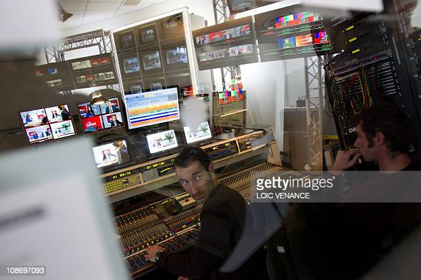 A man works on a mixing console at the I Tele news channel office on January 31 2011 in Paris AFP PHOTO LOIC VENANCE