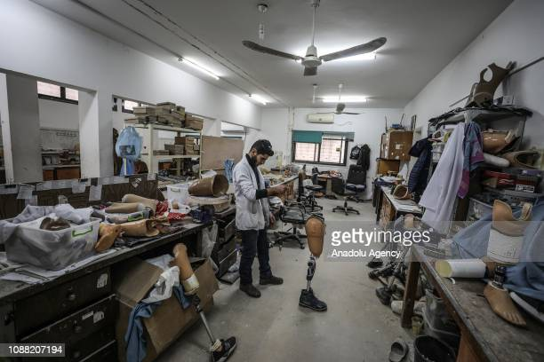 A man works on a prosthesis which were designed for Palestinians those who lost their legs in Israeli interventions during Great March of Return...