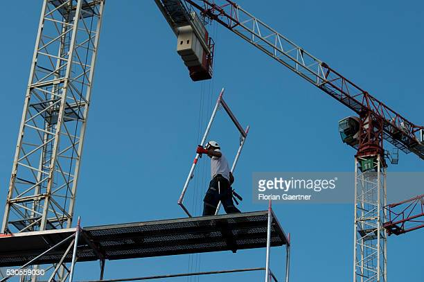 A man works on a scaffolding on May 11 2016 in Berlin Germany