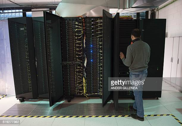 A man works on a supercomputer at the University of Cantabria in the northern Spanish city of Santander on March 16 2016 In Spain's historic port of...