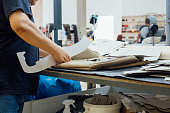 Man works on a upholstery leather factory
