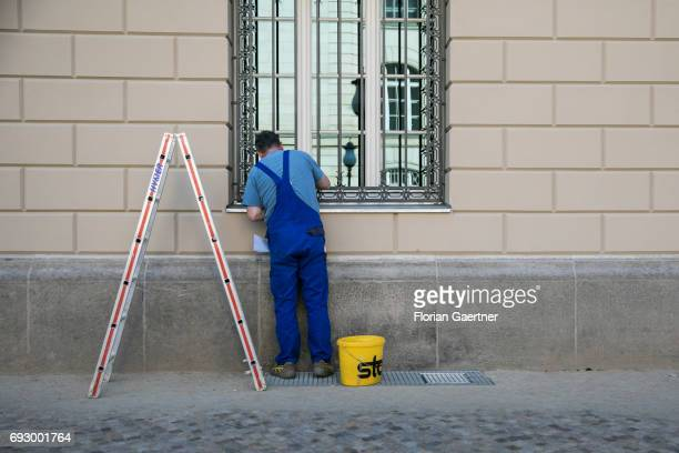 A man works on a window on May 22 2017 in Berlin Deutschland