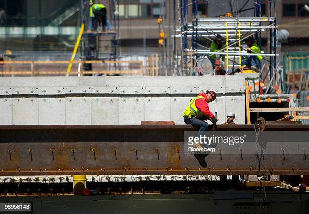 A man works on an I beam at the World Trade Center construction site in New York US on Monday May 10 2010 One World Trade Center formerly known as...