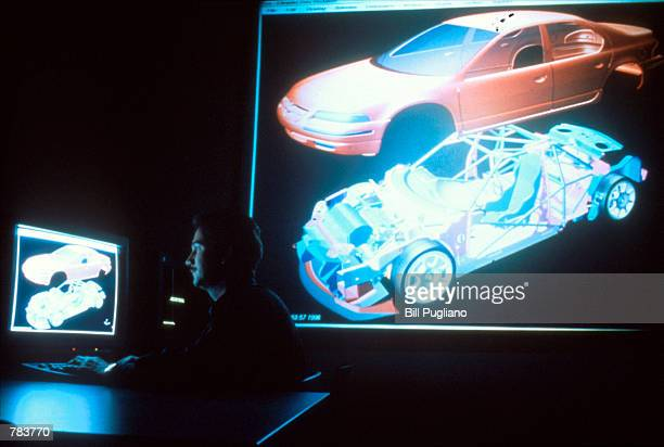 A man works on computer designs for the new Chrysler cars at the Chrysler Auto Motor Factory in Michigan on June 5 1996