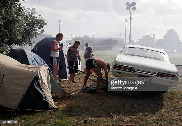A man works on his car during Street Machine Summernats 21 Car Festival held at Epic Park on January 5 2008 in Canberra Australia 110000 people are...