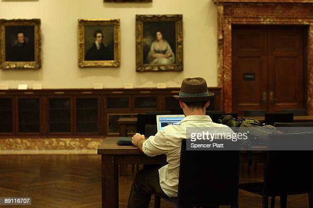 A man works on his computer in a newly opened reading room at the New York Public Library specifically for online users on July 20 2009 in New York...