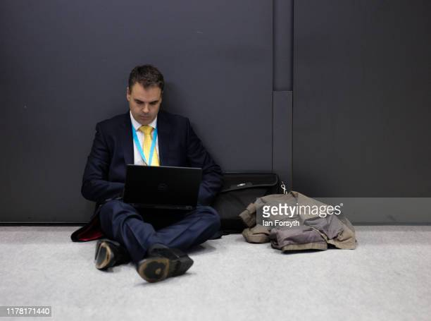 A man works on his laptop during the second day of the Conservative Party Conference at Manchester Central on September 30 2019 in Manchester England...