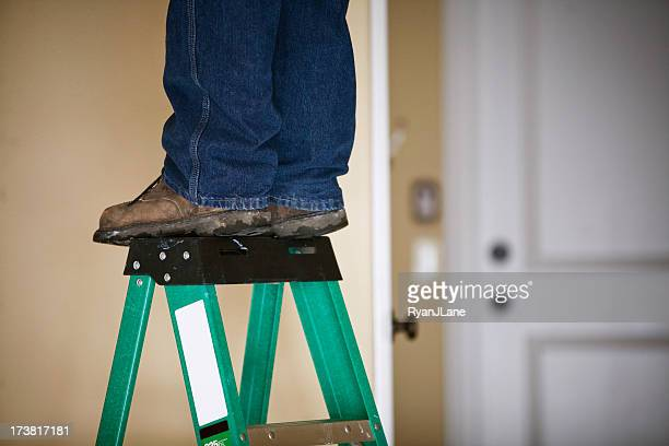 man works on home repair / feet and ladder - step ladder stock photos and pictures