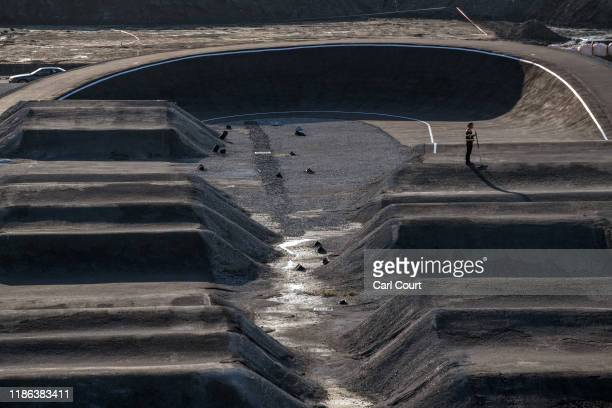 Man works on the BMX track which will form part of the Ariake Urban Sports Park for the 2020 Olympics, on December 4, 2019 in Tokyo, Japan.
