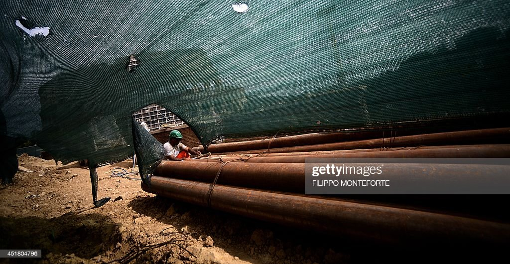 A man works on the construction site of the metro station fori a man works on the construction site of the metro station fori imperiali colosseo voltagebd Choice Image