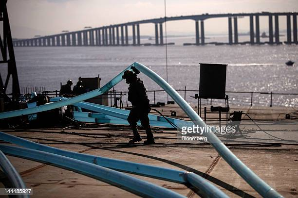 A man works on the deck of a Petroleo Brasileiro SA oil tanker under construction at the Maua SA shipyard in Niteroi Brazil on Thursday May 10 2012...