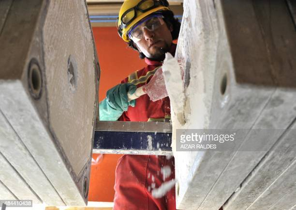 A man works on the extraction of Lithium carbonate from salpeter of the Uyuni salt pan the Llipi pilot plant in Uyuni south from La Paz on August 17...