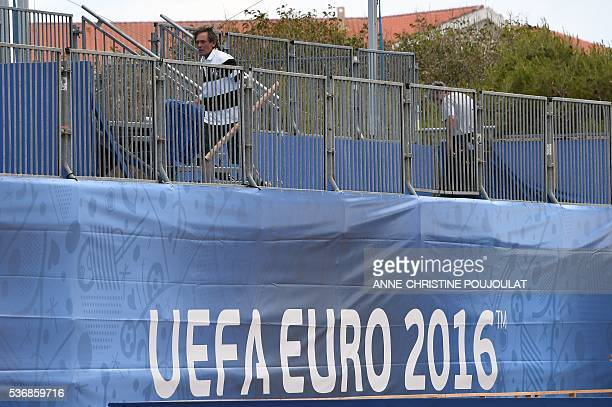 A man works on the fanzone site for the UEFA Euro 2016 on the Prado beaches in Marseille where supporters will gather to watch the games on June 1...